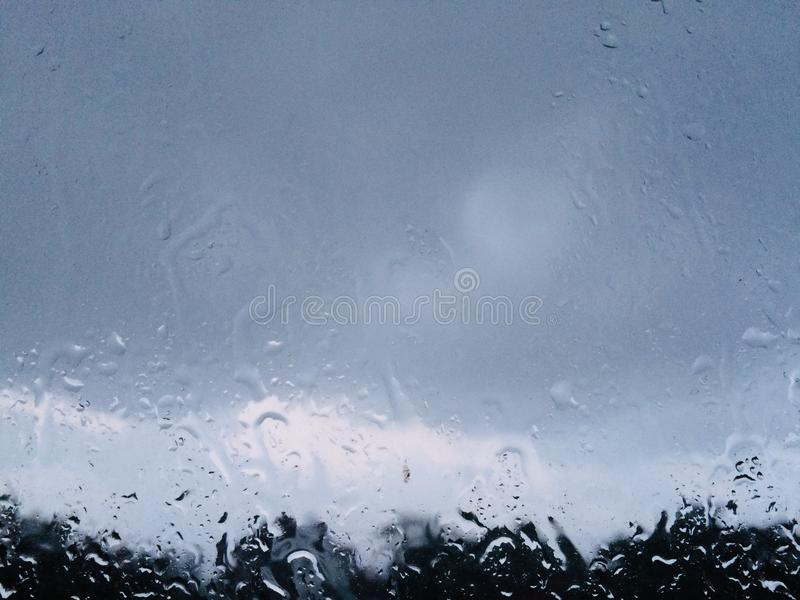 Rain drop on windshield blur outside view royalty free stock image