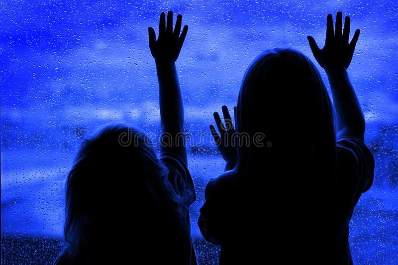 Rainy Day with Little Girls at Window Looking Out. Wanting to play royalty free stock photos