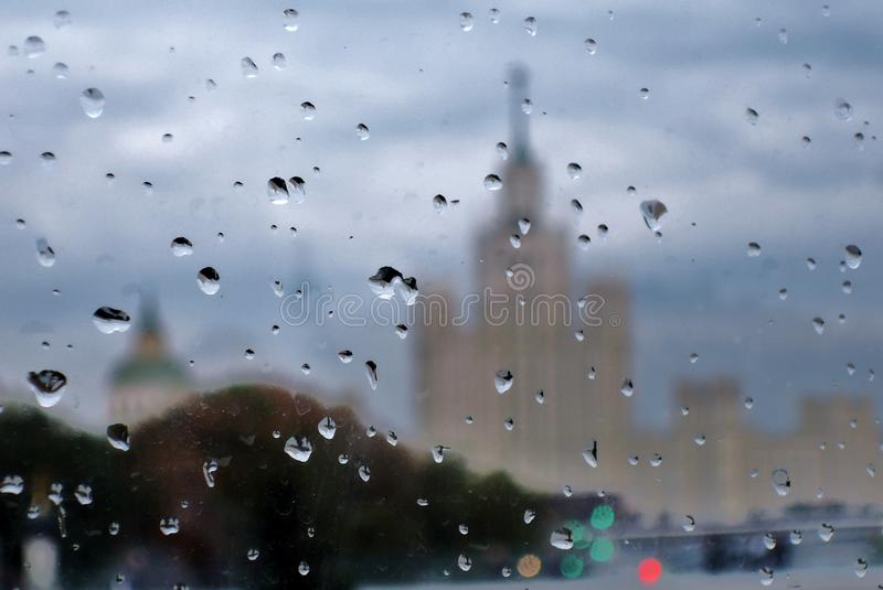 Rainy day in Moscow. Raindrops cover the glass. stock photos