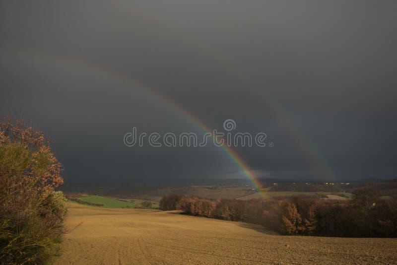 Rainy day in Tuscany with double rainbow, Chianciano Terme stock photo