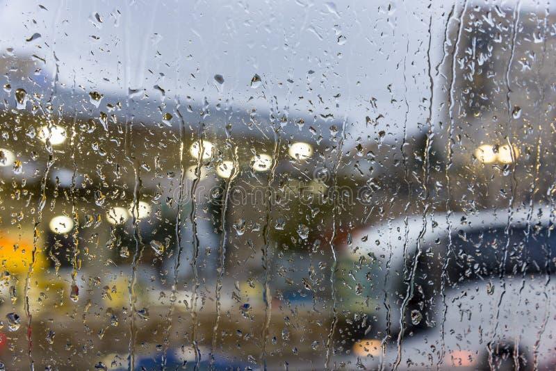 Rainy days,Rain drops on window,rainy weather,rain background,rain and bokeh. Rain on the weather window royalty free stock photos