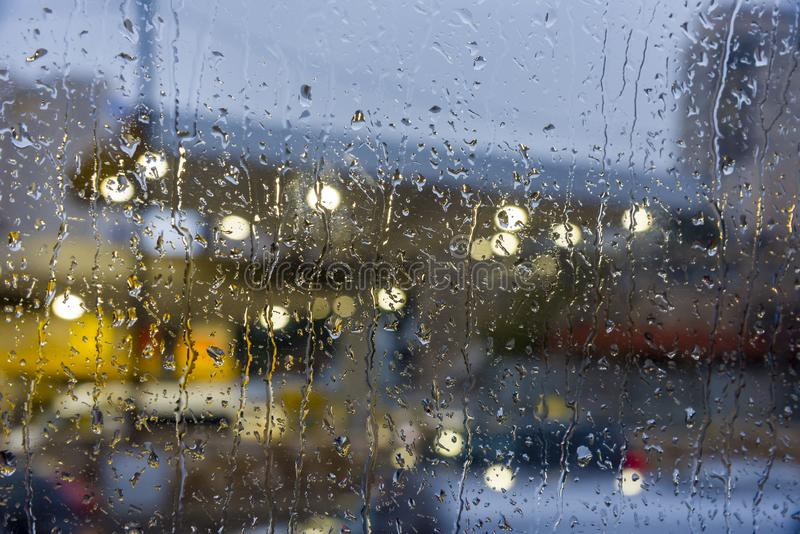 Rainy days,Rain drops on window,rainy weather,rain background,rain and bokeh. Rain on the weather window royalty free stock photo