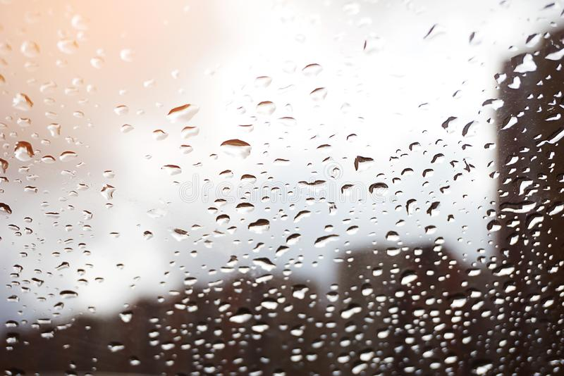 Rainy days, raindrops on the window, glass. Rainy weather, rain background, rain and bokeh. Water drops on window glass royalty free stock photo