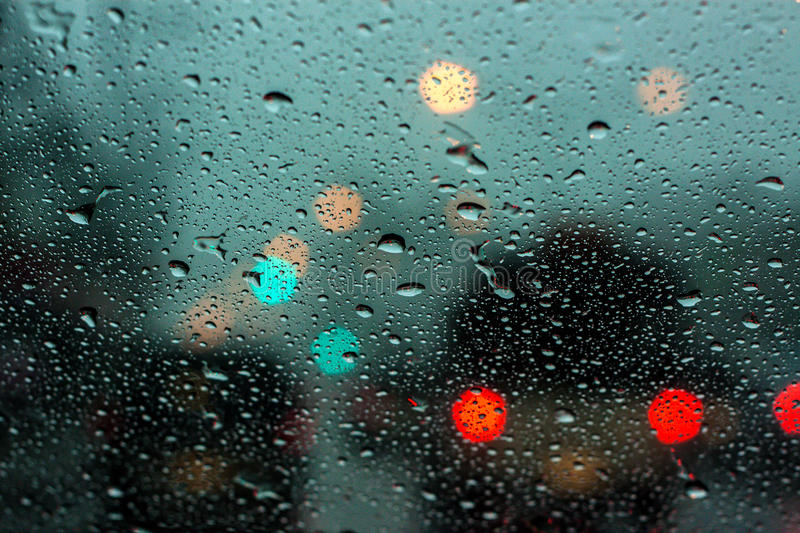 Rainy drop on mirror with bokeh. Rainy drop on car mirror with natural bokeh on the road royalty free stock photography