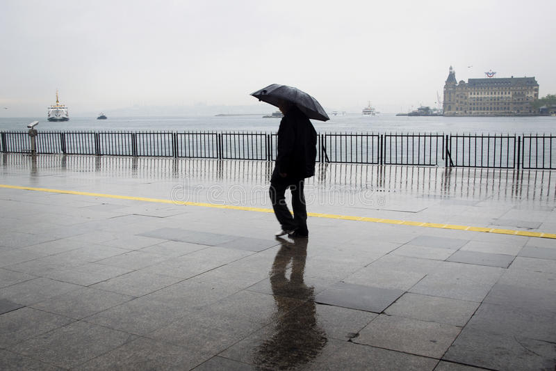 Rainy Istanbul coast, people and ships stock photography