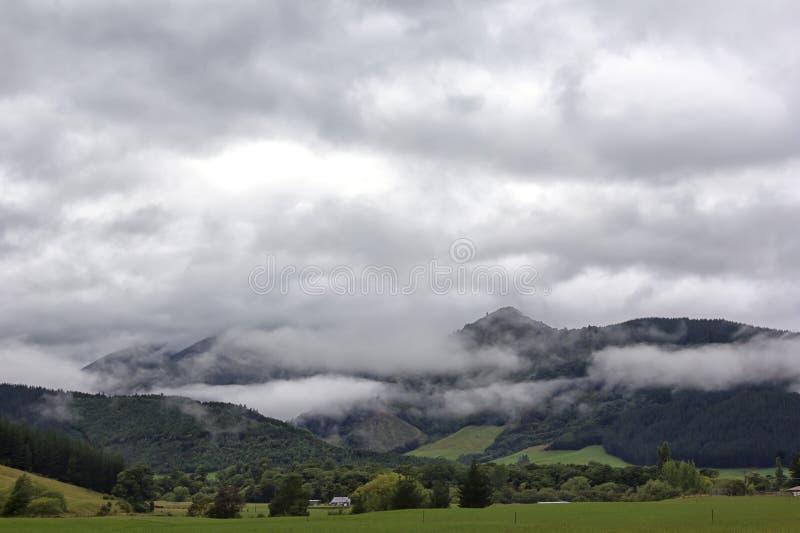 Rainy Landscape near Nelson, Eighty Eight Valley, New Zealand. Rainy Landscape with cloudy sky near Nelson, Eighty Eight Valley, New Zealand royalty free stock photos