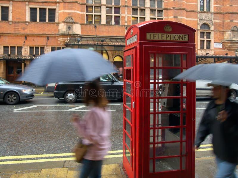 Rainy London. Shaftesbury Avenue, London, in the Rain; high ISO shot, some fine grain. Blurred pedestrians royalty free stock photography