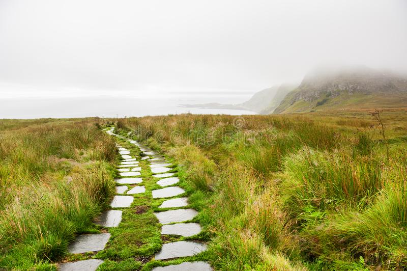 Rainy morning on Runde island in Norway royalty free stock photography