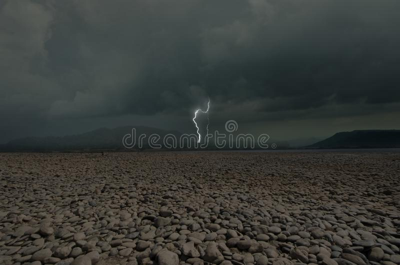 Rainy storm with strong lightning cover stone beach royalty free stock photo