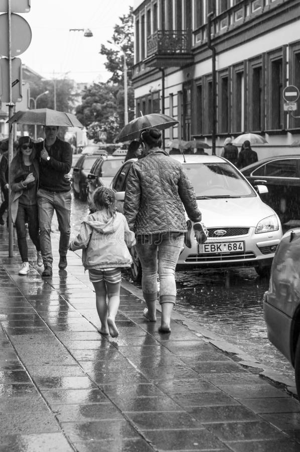 Rainy streets barefoot movement lesson. Black and White. royalty free stock photos