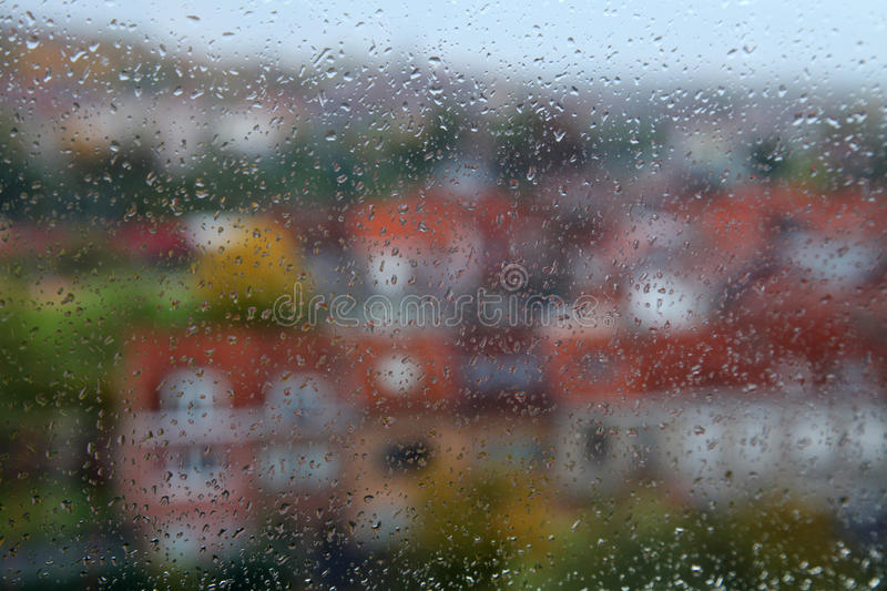 Rainy weather. In town as seen through the window stock images