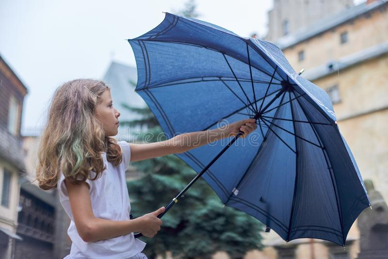 Rainy weather, portrait of beautiful little girl with an umbrella stock photography