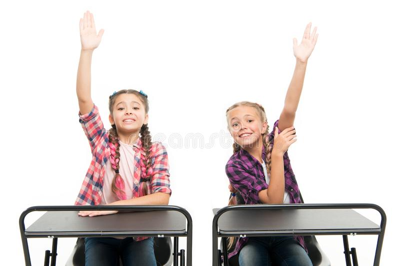 Raise hands to answer. Students classmates sit desk. Back to school. Private school concept. Elementary school education royalty free stock image