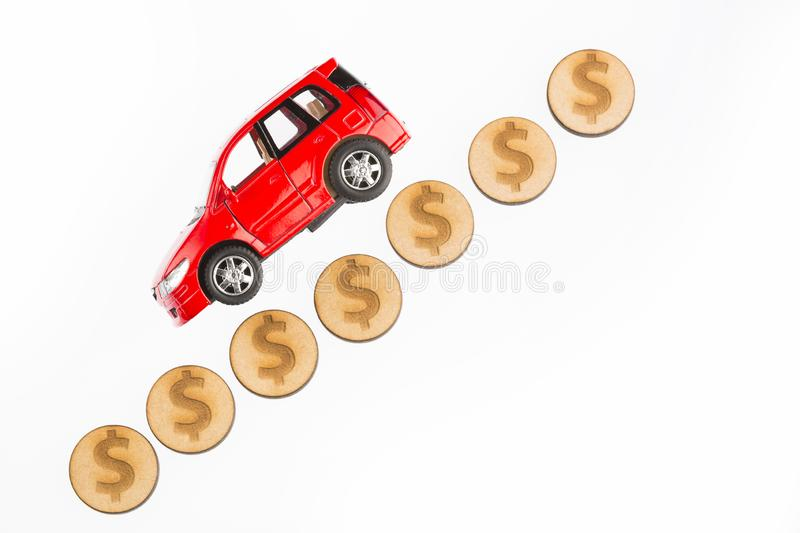 Raise and lower the value of the car - White background. Car model and coins. Concept of auto loan, auto insurance, leasing. Raise and lower the value of the car royalty free stock photography