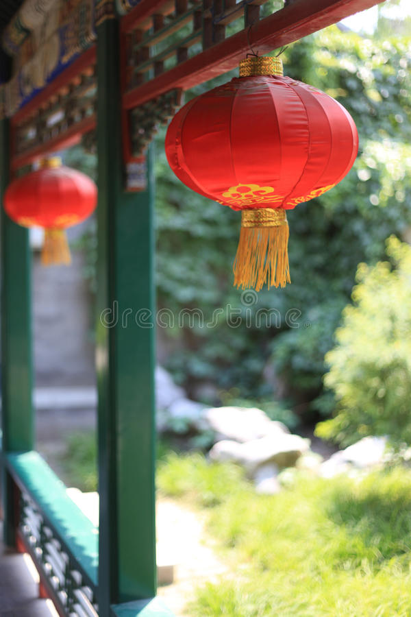 Raise the red lantern. Deep curtilage courtyard of the cloisters, lux lanterns hanging high above, highlight the festive and auspicious royalty free stock image