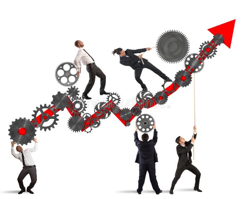Raise the statistics. Teamwork build an arrow upwards with gears mechanism royalty free stock photos