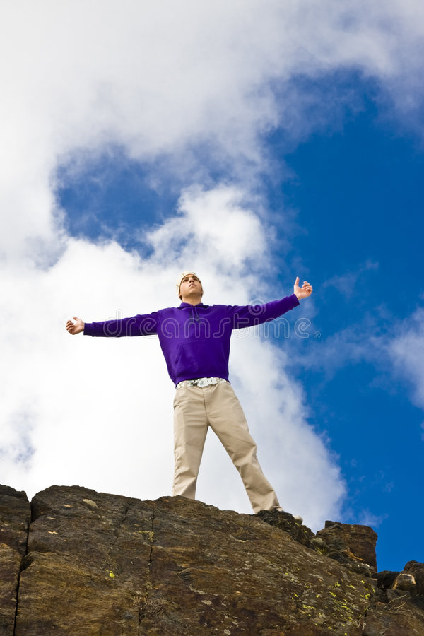 Raised arms man stock photography