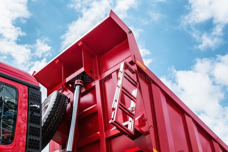 Raised body red dump truck. To remove soil stock images