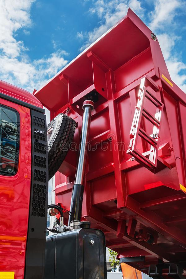 Raised body red dump truck. To remove soil stock image