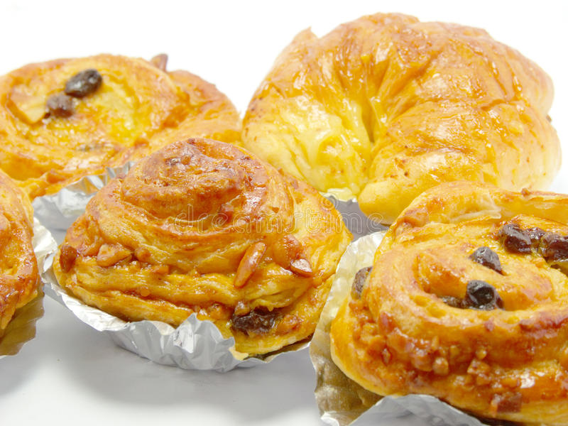 Raisin brioche sweet danish pastries. Closeup sweet fruit danish desserts royalty free stock photography