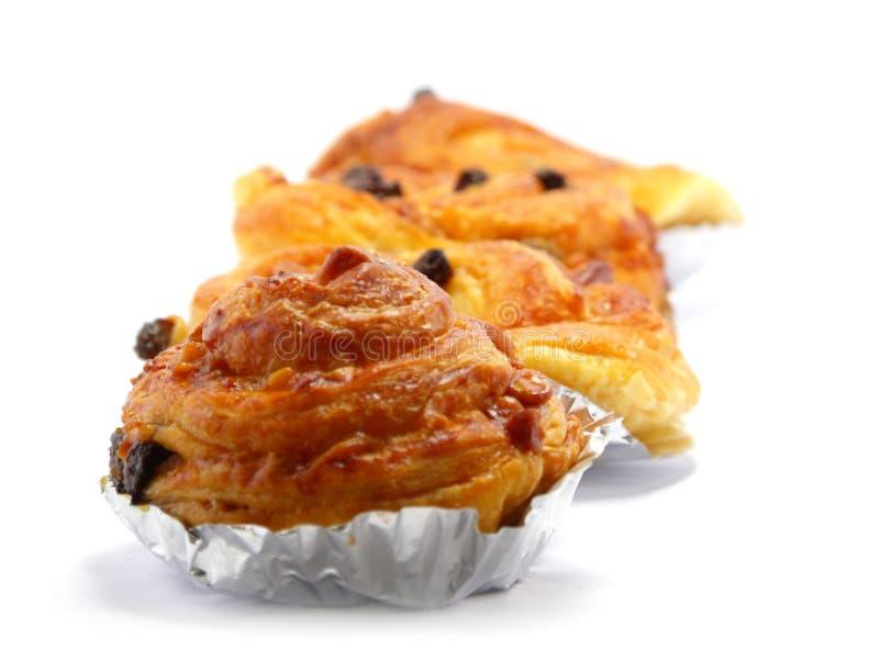 Raisin brioche sweet danish pastries. Raisin danish pastry isolated on white background stock photography