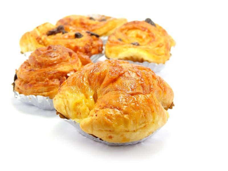 Raisin brioche sweet danish pastries. Danish pastry isolated on white background stock photo