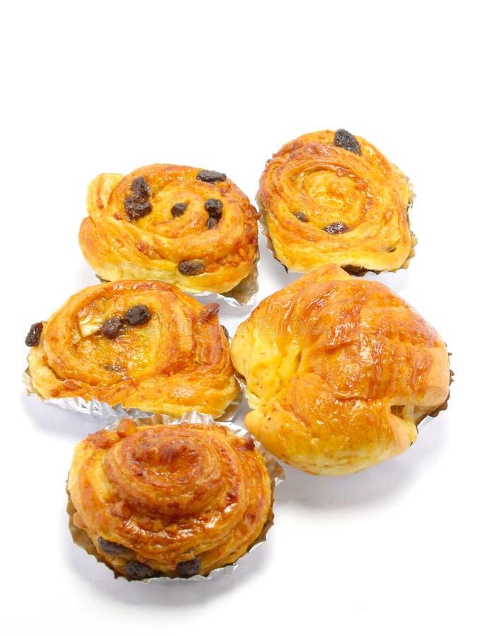 Raisin brioche sweet danish pastries. Raisin danish pastry isolated on white background royalty free stock photo