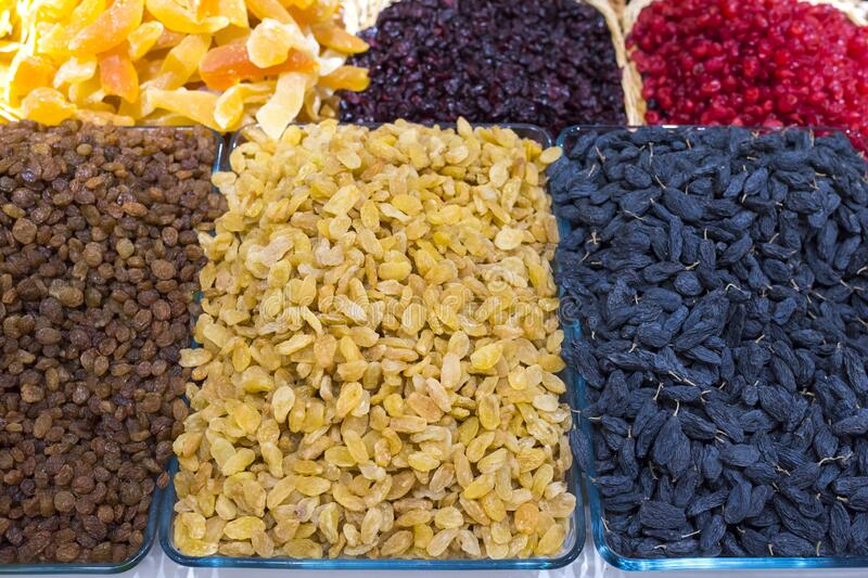 Raisin of different types, dried fruits. Delightful background or wall-paper, natural products stock photos