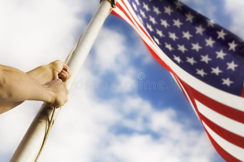 Download Raising An American Flag stock image. Image of hands - 14846217