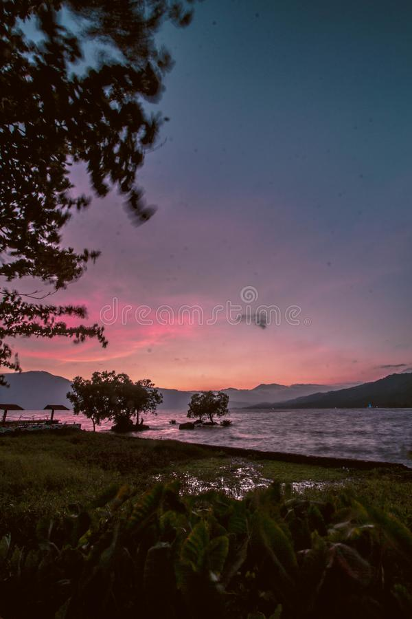 Raising fish in the middle of singkarak lake. Beautyful view of Singkarak lake and there is a fish farm in the middle of the lake, Indonesia stock image