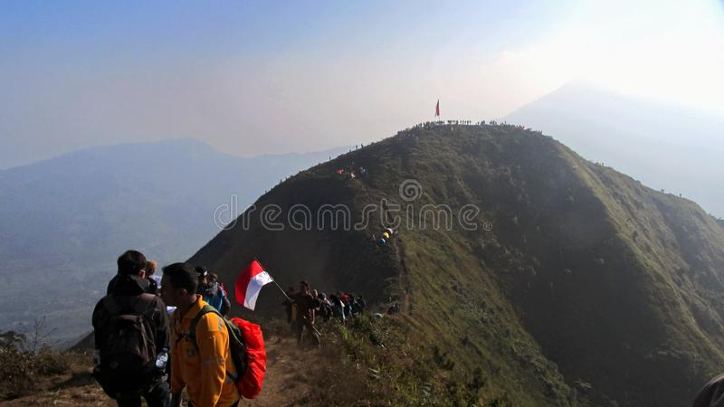 Raising the flag of independence at Andong Mountain Peak. At magelang Central Java Indonesia stock image
