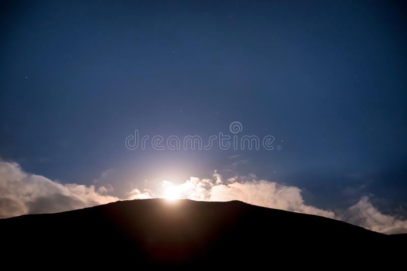 Raising of full moon above mountain royalty free stock image