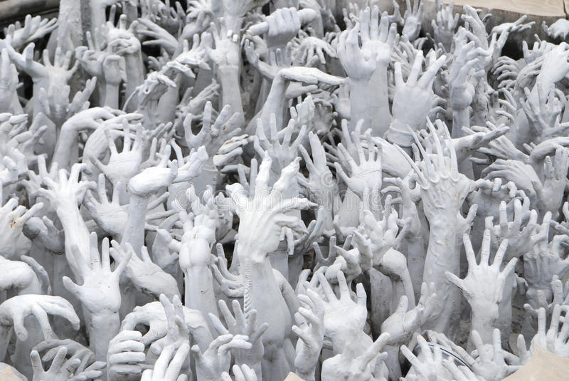 Raising hands sculpture royalty free stock image