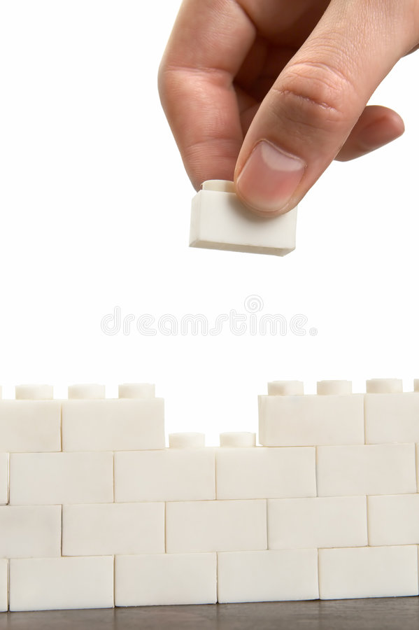 Raising the wall. Isolated over white stock photos