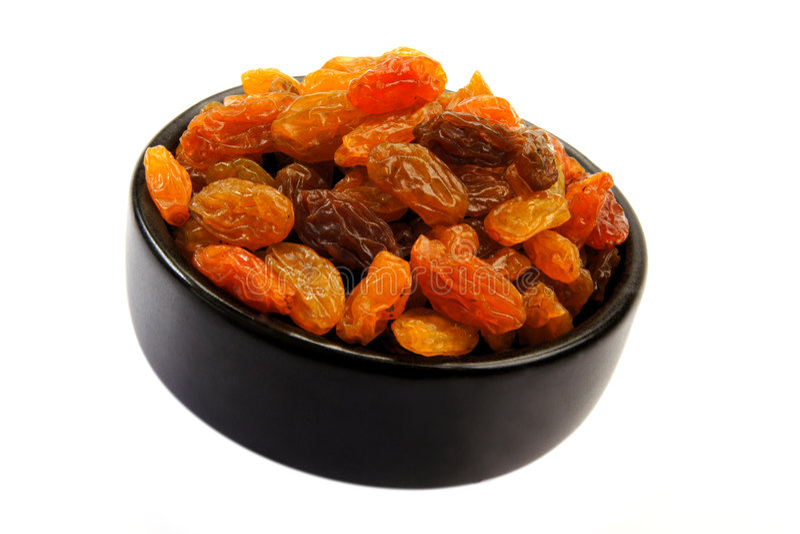 Raisins. Bowl of sweet raisins on white background royalty free stock images