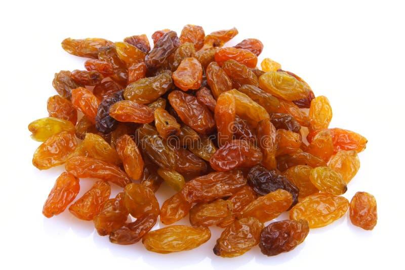 Raisins. Sweet raisins on white background royalty free stock photos