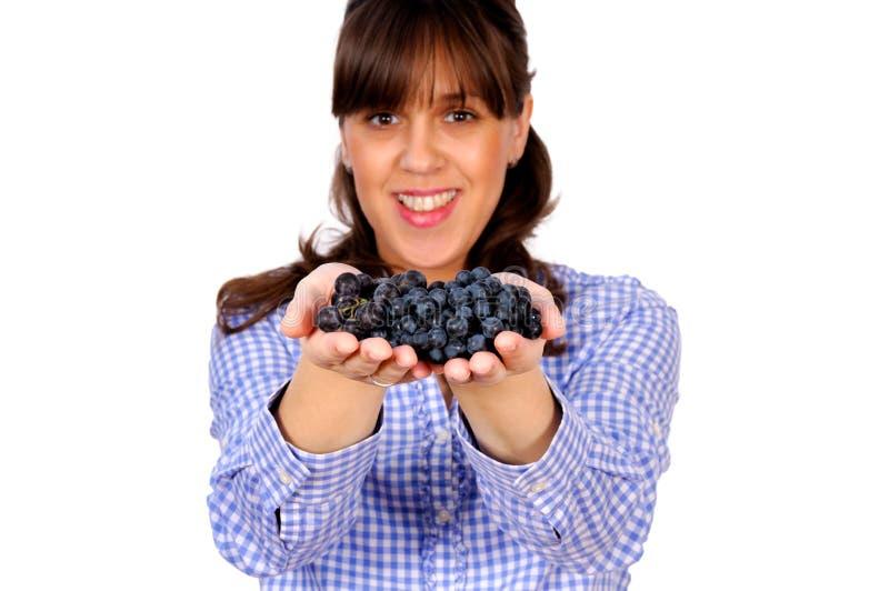 Raisins dans les mains image stock