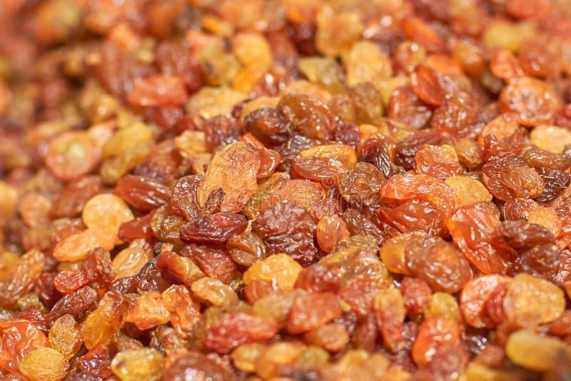 Raisins, dried grapes, closeup texture and background stock photos