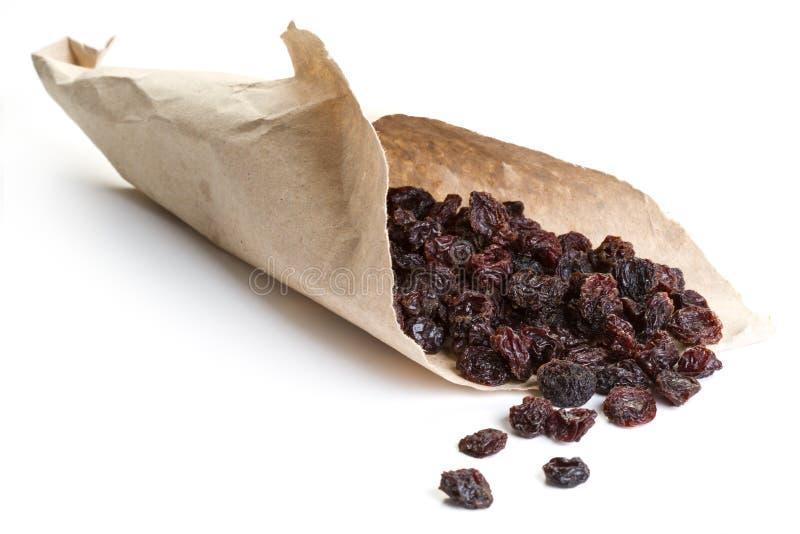 Raisins envolvidos no papel imagem de stock