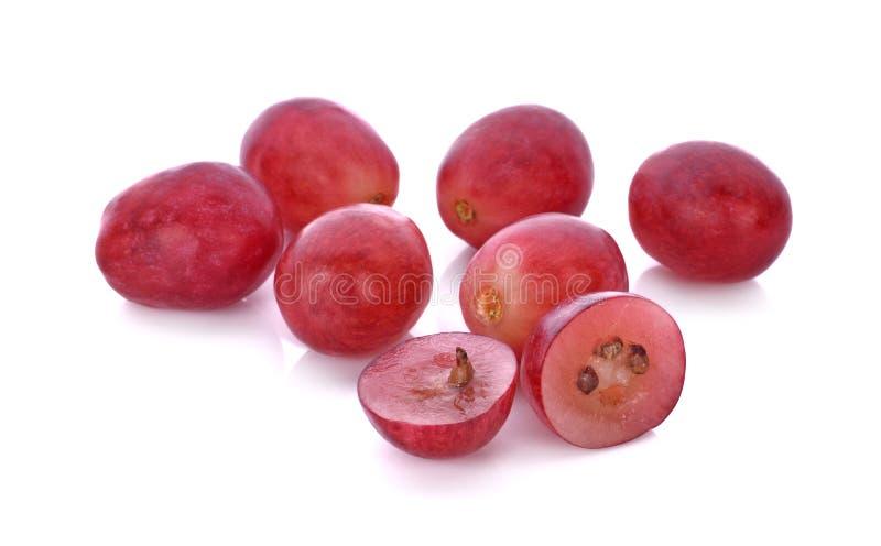 Raisins rouges d'isolement sur le fond blanc photographie stock