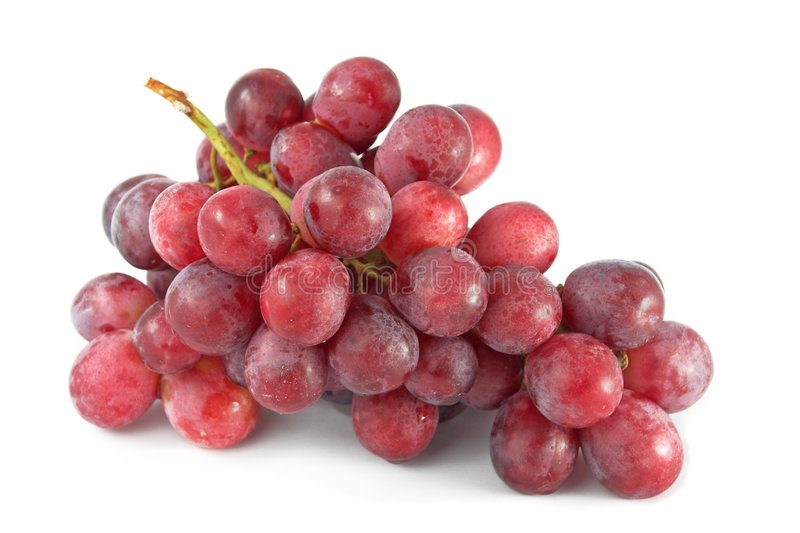 Raisins rouges sur le blanc image stock