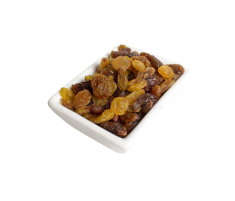 Raisins secs dans un plat Vue de ci-avant photographie stock libre de droits