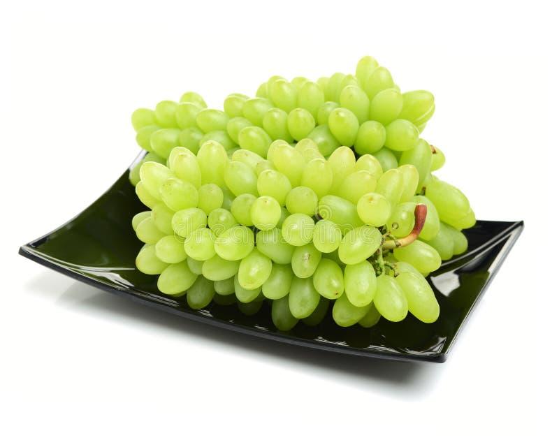 Raisins verts frais avec des baisses image libre de droits