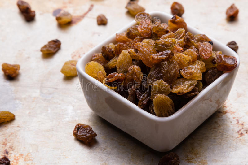 Raisins in a white bowl royalty free stock photography