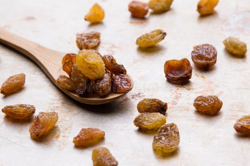 Raisins on wooden spoon stock photos
