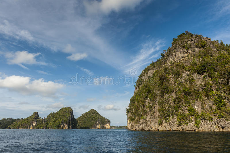 Raja Ampat Islands in West Papua, Indonesia. Raja Ampat is an archipelago comprising over 1,500 small islands and is the part of Coral Triangle which contains royalty free stock photography