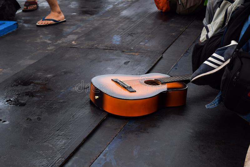 Guitar brown color was in the boat in Sebesi island, Indonesia. stock photography