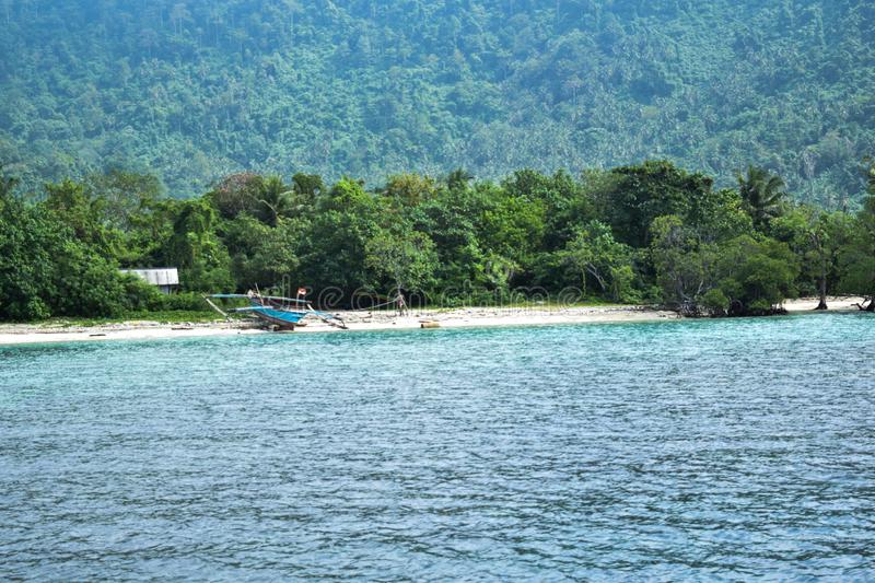 Unidentified boat on shore in Sebesi island, Indonesia royalty free stock photography