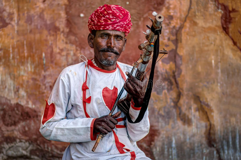 Rajasthani Folk Musician. A Rajasthani folk musician in action at Jaipur, India royalty free stock images