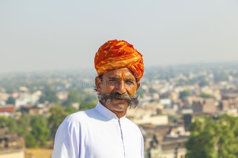 Rajasthani man with bright orange turban and bushy mustache stock photos